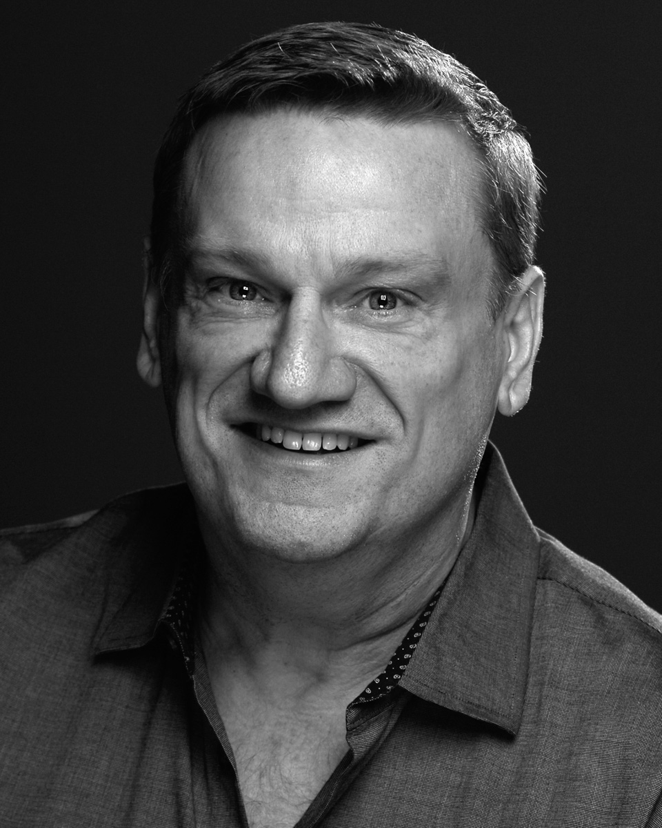 Headshot of Greg Allen